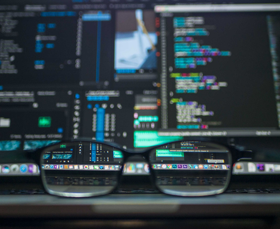 An image of glasses and a computer screen